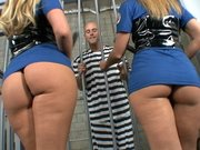 Two guards Phoenix and Brianna are showing their asses to a prisoner
