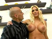 Carmel Moore talking with the cameraman and showing her huge fake tits