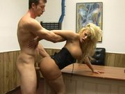 Shyla Stylez bends over the table and gets fucked doggie standing up