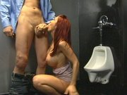 Redhead chick Kylee Strutt sucks hard cock in the Men s room