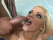 Delta White receives an open mouth facial cumshot