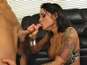 Angelina Valentine rubs his cock before he cums on her juggs