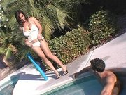 Busty MILF Sienna West kissing with a guy in the water pool