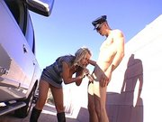 Pornstar Nikki Benz sucking big policeman cock outdoor