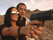 Sexy pornstar Jayden James learning how to shoot from a gun