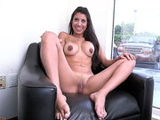 Soffie sitting nude in the armchair