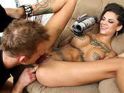 Bonnie Rotten recording on camera as she getting licked