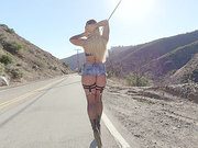 Hitchhiking blonde Kissa Sins picked up by cops on the highway