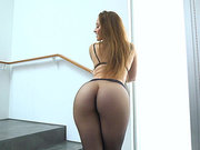 Hairy pussy babe Dani Daniels shows off her ass in pantyhose