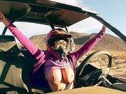 Busty mom Nikki Benz riding sandy buggy through the desert topless