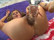 Sheena Shaw shoves huge glass dildo deep into her anus