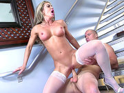 Stockings clad blonde Nina Dolci riding dick on the stairs