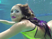 Busty August Ames dives in deep for an underwater tease