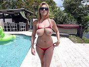Big tits blonde Jazmyn teases with her ass in a bikini