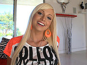 Rikki Six wearing sexy outfit talking with a cameraman