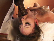 Jennifer White lays on her back as he fucks her throat with his black monster